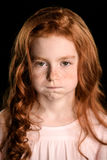 Portrait of adorable offended redhead girl looking at camera Stock Photo