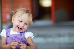 Portrait of adorable playful girl Stock Photos