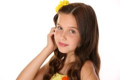 Portrait of an adorable preteen girl close-up. Portrait of a pretty young teenage girl close-up. Adorable preteen with dark hair, charming face and bare Royalty Free Stock Image