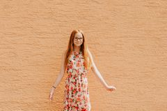 Portrait of adorable preteen kid girl. Of 10-11 yers old with long red hair, wearing eyeglasses stock images