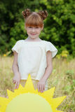 Portrait of adorable red-haired girl in park Stock Photo