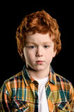 Portrait of adorable serious redhead boy looking at camera Royalty Free Stock Photo