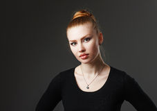 Portrait of a adorable sexy red-haired girl with plump lips. Stock Photography