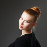 Portrait of a adorable sexy red-haired girl with plump lips. Stock Photos