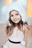 Portrait of adorable smiling child girl wearing fur hat. Fashion photo. Christmas, New Year, birthday, party time. Natural beauty Royalty Free Stock Images