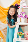 Portrait of adorable smiling girl in blue dress Stock Image