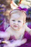 Portrait of an adorable smiling girl in lavender field. Little girl walking in a field of lavender. Outdoor summer portrait Royalty Free Stock Photos
