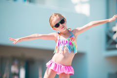 Portrait of adorable smiling little girl on beach vacation Stock Images