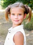 Portrait of adorable smiling little girl child in dress outdoor Royalty Free Stock Photography