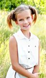 Portrait of adorable smiling little girl child in dress outdoor Royalty Free Stock Images