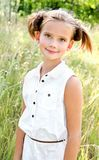 Portrait of adorable smiling little girl child in dress outdoor Royalty Free Stock Image