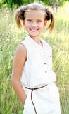 Portrait of adorable smiling little girl child in dress outdoor Stock Image