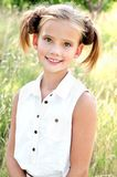 Portrait of adorable smiling little girl child in dress outdoor Stock Images
