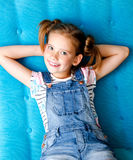 Portrait of adorable smiling little girl child having a rest. On the sofa Royalty Free Stock Photography