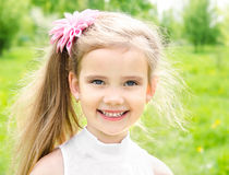 Portrait of adorable smiling little girl on the meadow Royalty Free Stock Photo