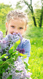 Portrait of adorable smiling little girl on the meadow Royalty Free Stock Images