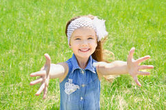 Portrait of adorable smiling little girl on the meadow Royalty Free Stock Photos