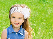 Portrait of adorable smiling little girl on the meadow Stock Photo