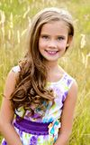 Portrait of adorable smiling little girl on the meadow  in summe Stock Photography