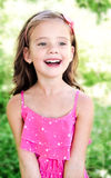 Portrait of adorable smiling little girl Stock Photos