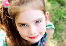 Portrait of adorable smiling little girl outdoor Stock Photography