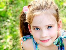 Portrait of adorable smiling little girl outdoor Royalty Free Stock Photos