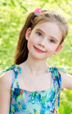Portrait of adorable smiling little girl outdoor stock image