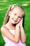 Portrait of adorable smiling little girl in the park Stock Photo