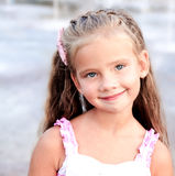 Portrait of adorable smiling little girl in the park Stock Images