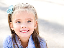 Portrait of adorable smiling little girl in the park Stock Photography