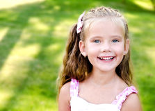 Portrait of adorable smiling little girl in the park Royalty Free Stock Image