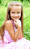 Portrait of adorable smiling little girl in summer day Stock Images