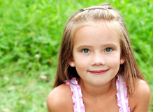 Portrait of adorable smiling little girl in summer day Royalty Free Stock Image