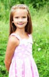Portrait of adorable smiling little girl in summer day Royalty Free Stock Photography