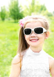 Portrait of adorable smiling little girl in sunglasses Royalty Free Stock Images