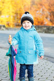 Portrait of adorable toddler boy with blue jacket and colorful u Stock Photo