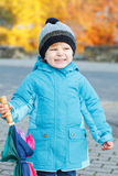 Portrait of adorable toddler boy with blue jacket and colorful u Stock Photography