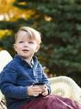 Portrait of a adorable toddler boy  with a cup of tea on a park Royalty Free Stock Photos
