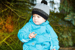 Portrait of adorable toddler boy in warm winter clothes on cold Royalty Free Stock Images