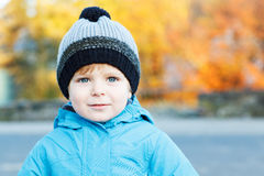 Portrait of adorable toddler boy in warm winter clothes on cold. Day, outdoors stock images