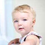 Portrait of adorable toddler girl indoors Stock Photo