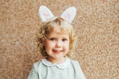 Portrait of adorable toddler girl wearing bunny ears stock photos
