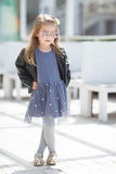 Portrait of an adorable toddler girl wearing fashion clothes. Stock Photos