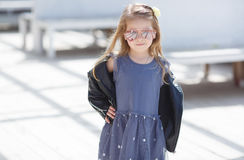 Portrait of an adorable toddler girl wearing fashion clothes. Royalty Free Stock Photography
