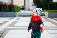 Portrait of adorable trendy a child on a one of european street. Concept of baby child fashion, leisure and travel Royalty Free Stock Photos