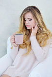Portrait of adorable woman holding a cup of hot tea Stock Images