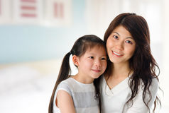 Young girl and mother at home. Royalty Free Stock Photos