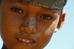 Portrait of adorable young happy boy - african poor child, pover Royalty Free Stock Photos