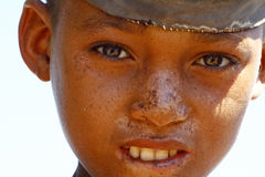 Portrait of adorable young happy boy - african poor child, pover Stock Photos