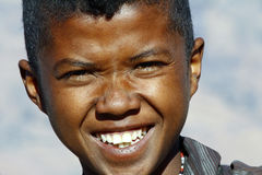 Portrait of adorable young happy boy - african poor child Stock Photo